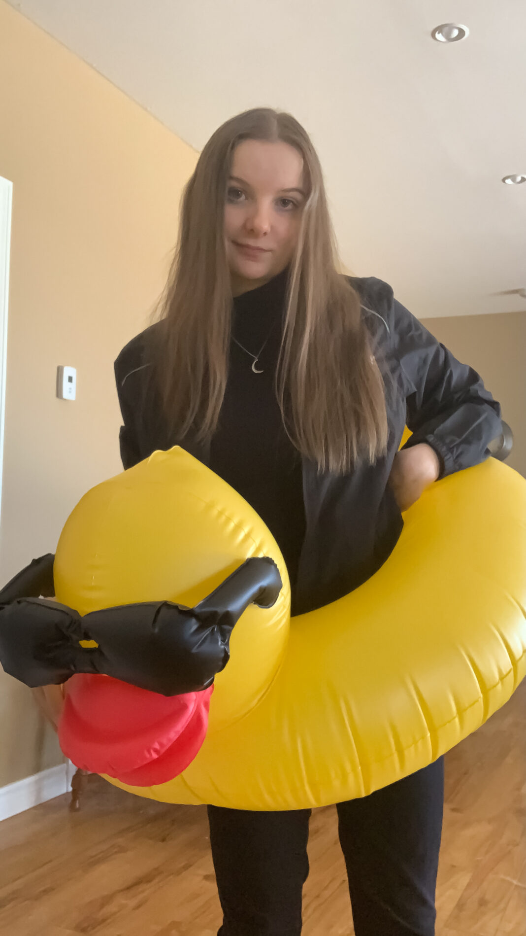 Girl with long blond hair with a rubber duck