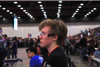 Person with short brown hair at an FRC Event