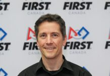 Dave Ellis in front of FIRST Canada logo