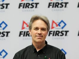 photo of mark breadner in front of FIRST Canada logo